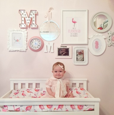 Gallery wall for girls nursery, changing table